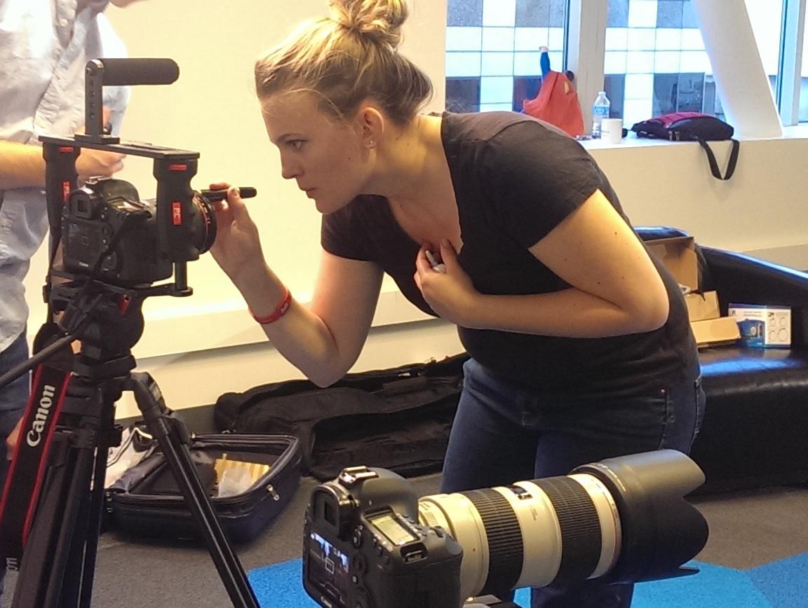 Director Ashley Maria setting up a shot